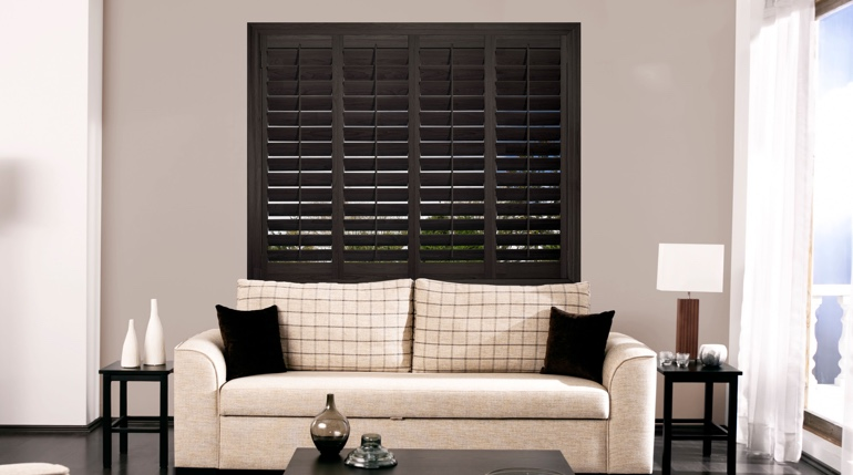 Atlanta sunroom with black shutters.
